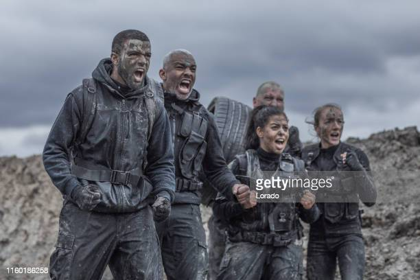 military mud run group - sports team event stock pictures, royalty-free photos & images