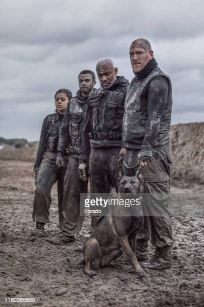military mud run group with a working dog - army training stock pictures, royalty-free photos & images