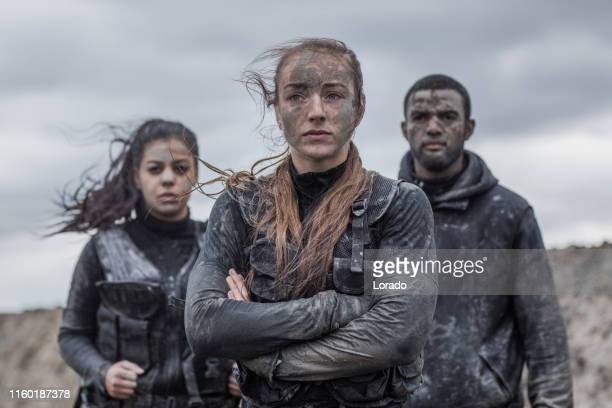 military mud run portrait of 3 young soldiers - army training stock pictures, royalty-free photos & images