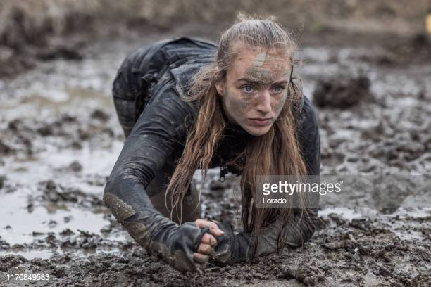 military mud run portrait of a female soldier - army training stock pictures, royalty-free photos & images