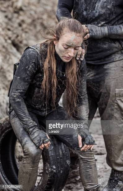 military mud run portrait of a female soldier - life in the trenches stock pictures, royalty-free photos & images