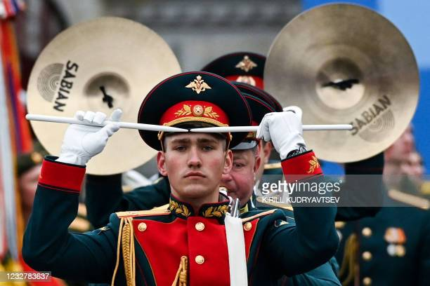 Military musicians perform on Red Square during the Victory Day military parade in Moscow on May 9, 2021. - Russia celebrates the 76th anniversary of...