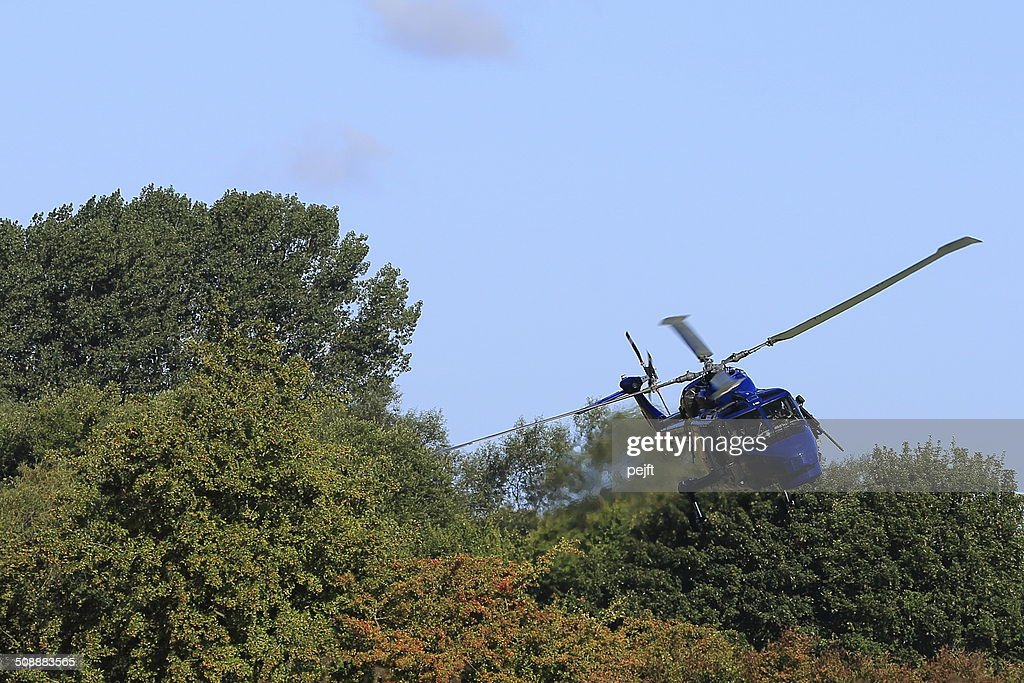 Military naval helicopter in action : Stock Photo