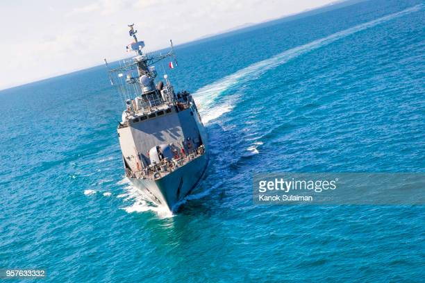 Military navy ships in a sea bay view from helicopter