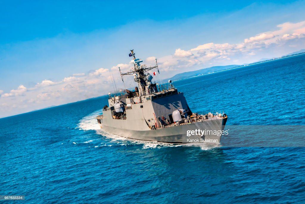 Military navy ships in a sea bay view from helicopter : Stock Photo