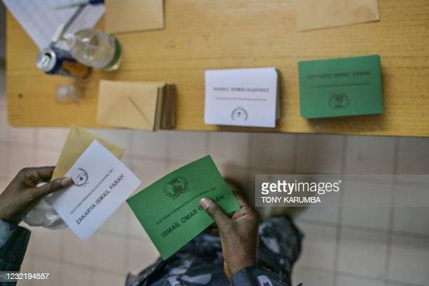 Military officer collects his ballot cards bearing the names of the contending presidential candidates as he prepares to cast his ballot at the...