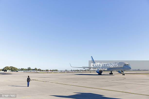 S Military officer greets US VicePresident Joe Biden onboard Air Force Two at Sydney Airport on July 18 2016 in Sydney Australia Biden is visiting...