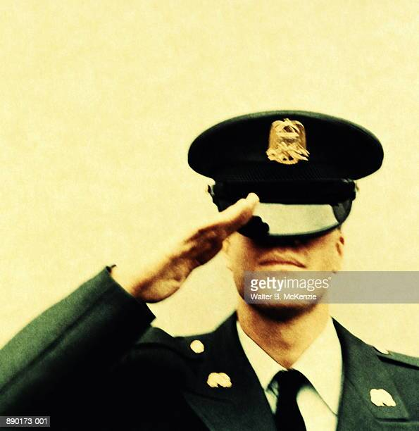 military officer saluting, hat covering eyes (paper negative) - uniform cap stock pictures, royalty-free photos & images
