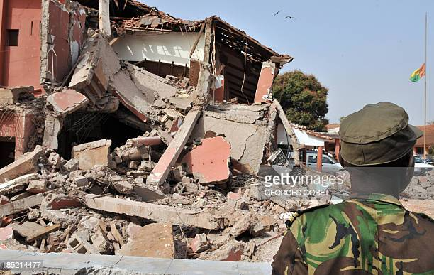 A military officer stands on March 4 2009 in front of the ruined remains of the military headquarters where a bomb attack killed General Tagme Na...