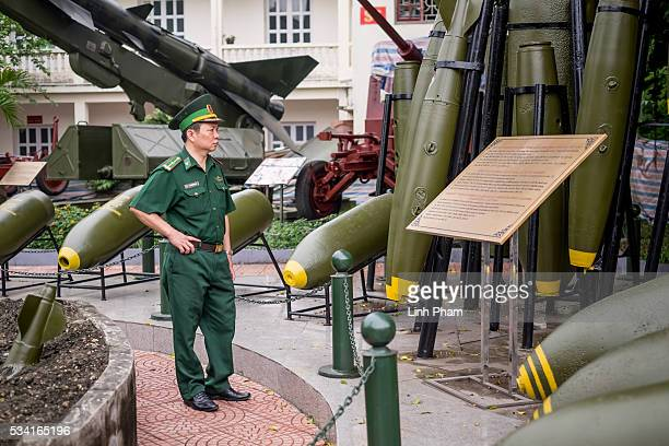 A military officer watches an bomb exhibition at Vietnam Military History Museum on May 25 2016 in Hanoi Vietnam US President Obama made his historic...