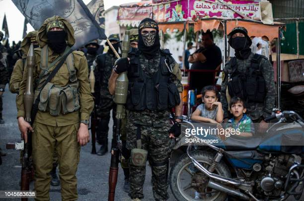 Military officers are seen standing holding weapon during the march Members of the Palestinian AlQuds Brigades the military wing of the Islamic Jihad...