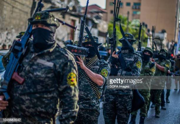 Military officers are seen walking in a queue holding guns during the march Members of the Palestinian AlQuds Brigades the military wing of the...