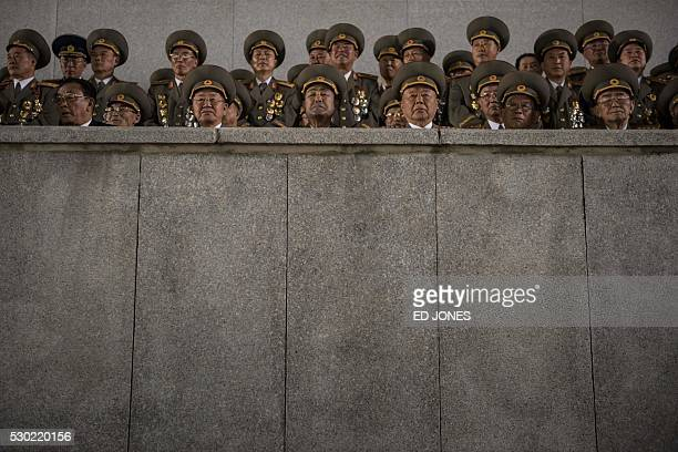 Military officers attend a torchlight parade on Kim IlSung square during festivities marking the end of the 7th Workers Party Congress in Kim IlSung...