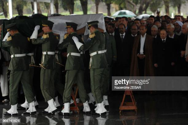 Military officers carry the wooden coffin of Algeria's first postindependence president Ahmed Ben Bella during his national funerals on April 13 2012...
