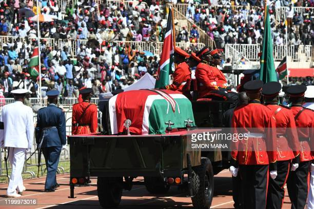 Military officers escort a gun carriage carrying the coffin of late former Kenya President Daniel Arap Moi draped in the Kenya national flag during a...