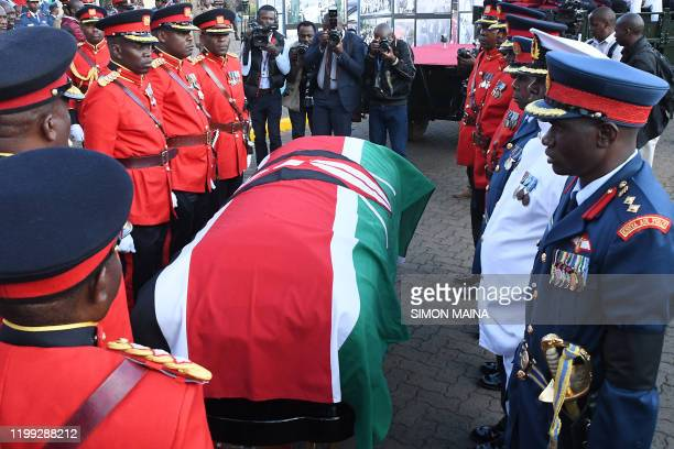 Military officers escort the coffin of late former Kenya's President Daniel Arap Moi draped in the National Flag into Parliament Buildings to...