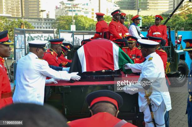 Military officers offload the casket with the body of the late Daniel Arap Moi to lieinstate at Parliament buildings for public viewing The former...