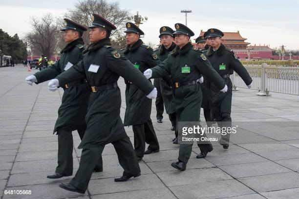 Military officers patrol on Tiananmen square before the opening session of the National People's Congress at the Great Hall of the People on March 5...
