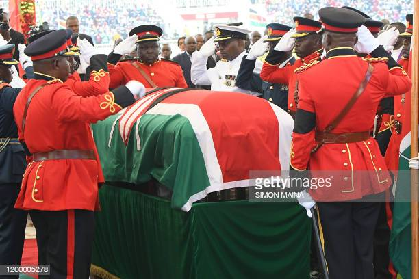 Military officers salute the coffin of late former Kenya President Daniel Arap Moi draped in the Kenya national flag during a funeral service at the...