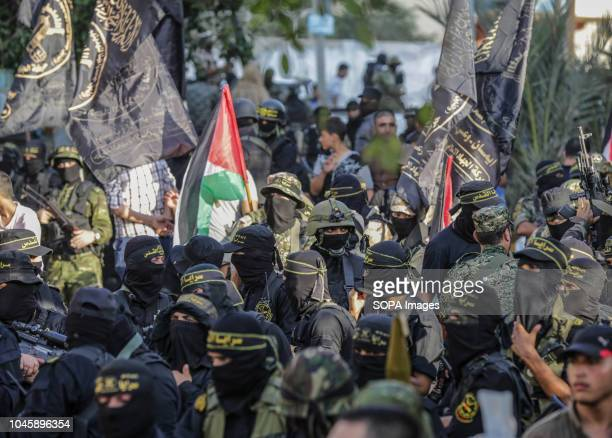 Military officers seen during the parade Members of the Palestinian AlQuds Brigades the military wing of the Islamic Jihad group march in the streets...