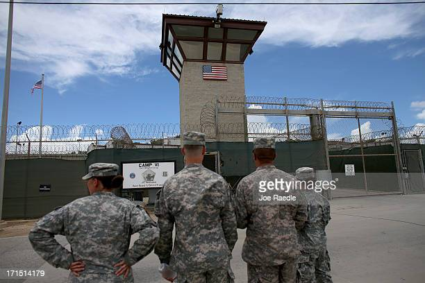 Military officers stand at the entrance to Camp VI and V at the U.S. Military prison for 'enemy combatants' on June 25, 2013 in Guantanamo Bay, Cuba....