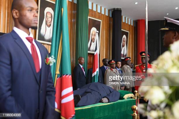 Military officers stand guard in front of the body of late Daniel arap Moi Kenya's second president lyinginstate at the parliament buildings on 8...
