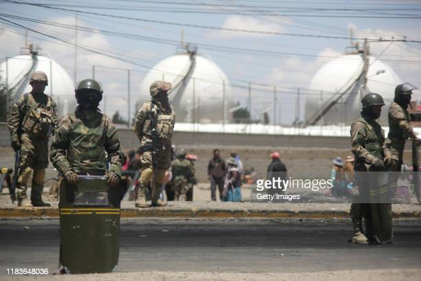 Military officers stand guard in front of YPFB Senkata Fuel Plant as supporters of Evo Morales block the road on November 20 2019 in El Alto...