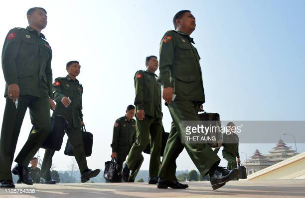 Military officers who are appointed members of the Myanmar Parliament arrive to attend a session in Naypyidaw on February 19, 2019. - Myanmar set up...