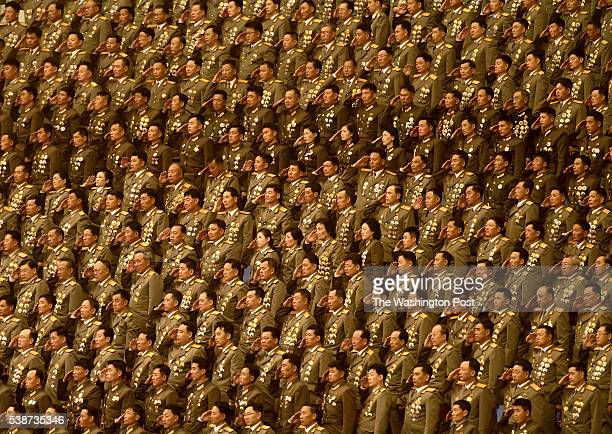 Military officials salute during a patriotic concert in the Pyongyang Arena in Pyongyang, North Korea on May 11, 2016. The three-hour concert...