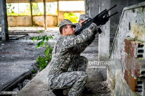 military operation - military invasion stock pictures, royalty-free photos & images