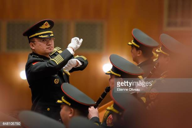 Military orchestra conductor leads the band during the opening session of the National People's Congress at The Great Hall of People on March 5 2017...