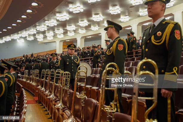 Military orchestra members enter The Great Hall of People during the opening session of the National People's Congress at The Great Hall of People on...