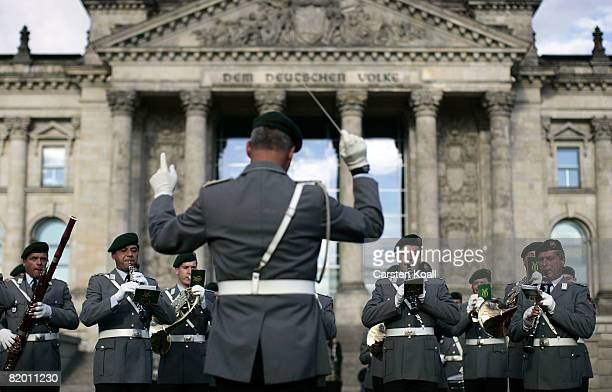 Military orchestra play prior 500 Recruits of the German armed forces the Bundeswehr attend their swearingin ceremony in front of the Reichstag on...