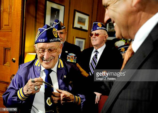 Military Order of the Purple Heart member and WWII veteran with the Navy Homer Stewart thanks Governor Ritter for giving him his pen after signing a...