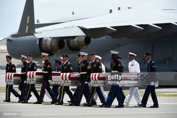 TOPSHOT Military pallbearers carry the believed to be remains of US service members collected in the Democratic People's Republic of Korea during...