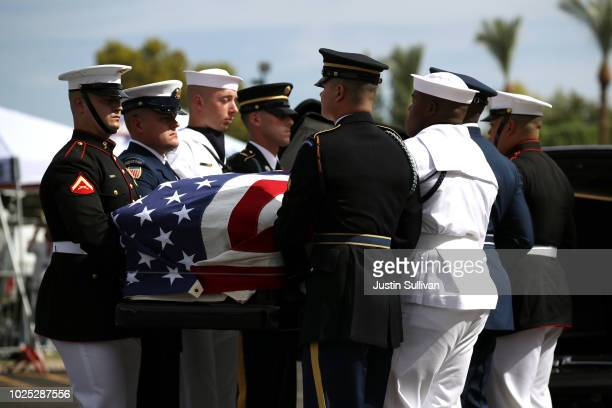 Military pallbearers carry the casket of US Sen John McCain in to a memorial service at the North Phoenix Baptist Church on August 30 2018 in Phoenix...