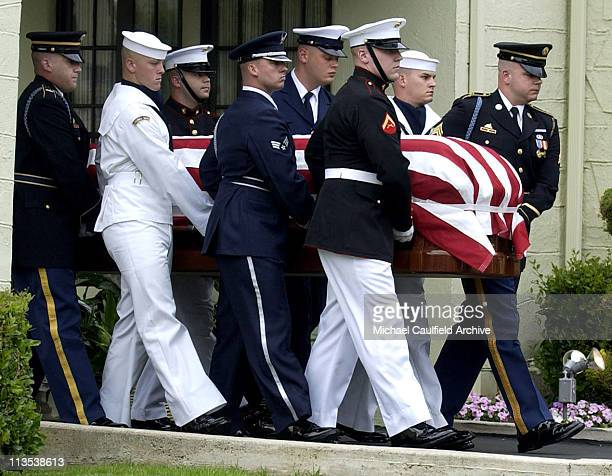 Military pallbearers carry the coffin of former President Ronald Reagan to the hearse at Gates Kingsley and Gates Moeller Murphy funeral home in...