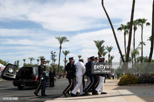 Military pallbearers escort the casket of US Sen John McCain in to a memorial service at the North Phoenix Baptist Church on August 30 2018 in...