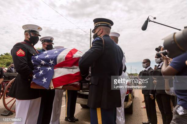 Military pallbearers prepare to place the body of former Rep John Lewis into a hearse after being carried across Edmund Pettus Bridge on July 26 2020...