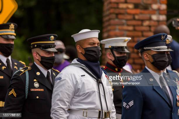 Military pallbearers wait at the end of Edmund Pettus Bridge for the horse drawn carriage carrying the body of civil rights icon, former US Rep. John...