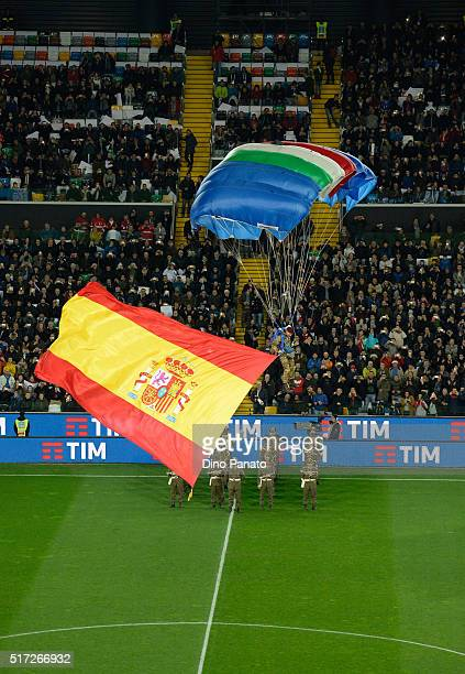 A military parachutist lands in the stadium with Spain flag before the international friendly match between Italy and Spain at Stadio Friuli on March...
