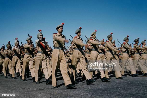 A military parade along the Rajpath in Delhi India possibly the Delhi Republic Day parade circa 1965