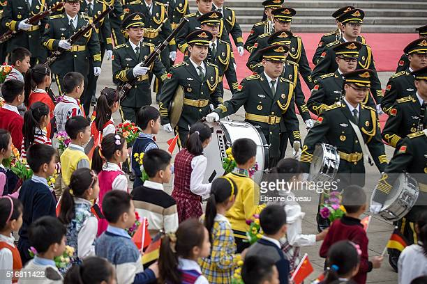 Military parade gets in position walking in front of a kid welcoming group at the Great Hall of the People on March 21, 2016 in Beijing, China. At...