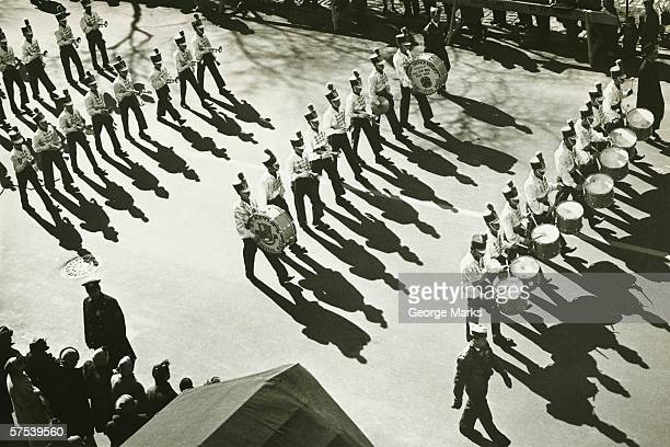 military parade, marching band performing, (b&w), (elevated view - marching band stock pictures, royalty-free photos & images