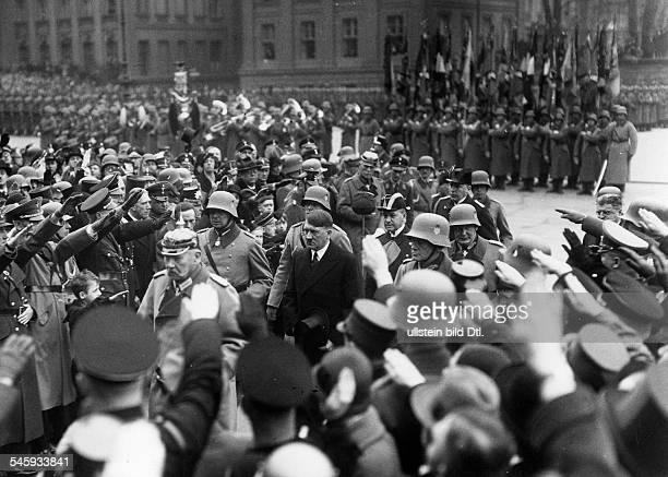 Military parade on the street 'Unter den Linden' Paul von Hindenburg on the to the memorial monument Neue Wache Behind him Werner von Blomberg Adolf...
