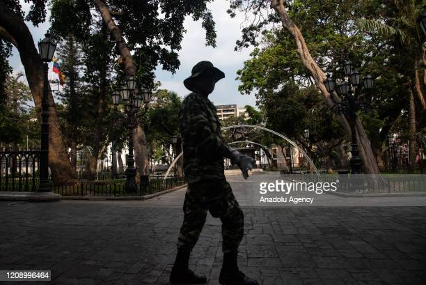 A military passes by empty Bolivar Square as a preventive measure against the new type of coronavirus pandemic in Caracas Venezuela on April 02 2020