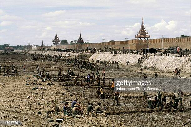 Military personal handdredging and cleaning the palace moat Mandalay Myanmar