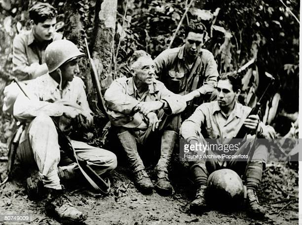 March 1944 United States General Joseph Stilwell centre pictured with a group in the Burmese jungle during World War II General Joseph Joe Stilwell...