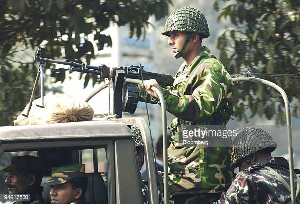Military personel take part in an armoured patrol on the streets of Dhaka Bangladesh on January 8 2007 A state of emergency was declared in Dhaka on...