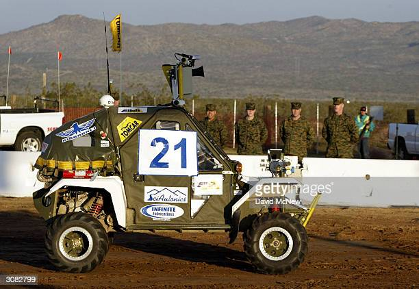 Military personel watch as the SciAutononics II autonomous or unmanned vehicle leaves the starting line in a quest for a milliondollar prize at the...